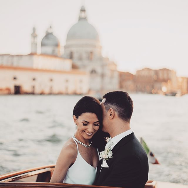 A post-ceremony boat ride along the grand canal #howromantic
