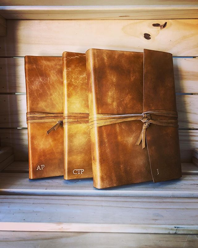 Some wraparound journals in whiskey that we finished off over the weekend. • • • #leather #leathercraft #journal #notebook #diary #sketchbook #bulletjournal #bookbinding #bookbinder #artisan #handmade #leatherbook #leatherjournal #book #travel #adventure #outdoors #traveljournal