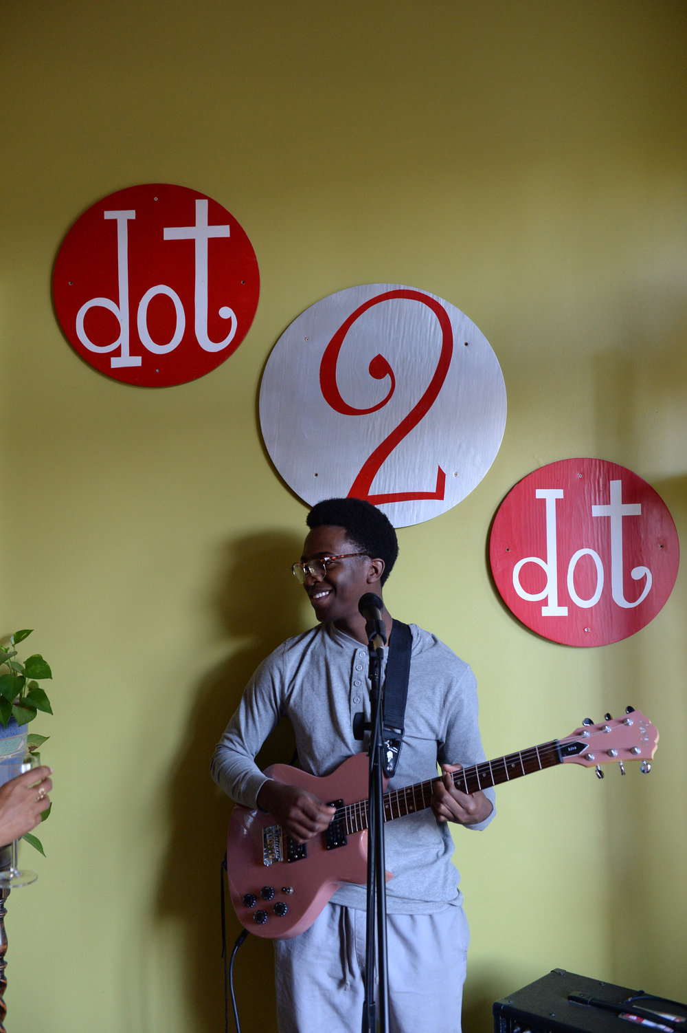 That sign was made for singing under! Mas from Atlanta (we heard him busking in  DeKalb square) graced us with his vocals and musical talents.