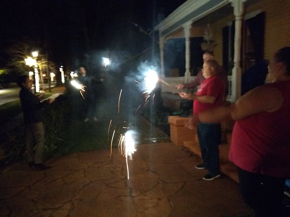 Big kids with extra long sparklers seeing in the New Year.