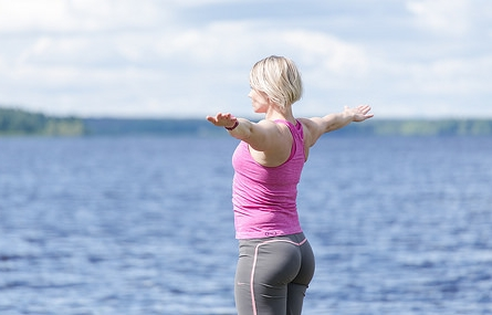 Practice yoga by the lake