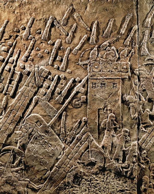 Erich Lessing  Defending the Judahite town of Lachish, soldiers fling lighted torches and debris on attacking Assyrians, in this relief from the palace of the Assyrian king Sennacherib (704–681 B.C.E.) in Nineveh. The square mound on top of the tell in the aerial photo is the eighth-century B.C.E. palace at Lachish.  In besieging Lachish, the Assyrians constructed a huge fan-shaped ramp—225-feet-wide at its base—large enough to accommodate five four-wheeled battering rams. This ramp was built to the right of the rectangular structure (the ancient city gate) just below the left central edge of the mound. In excavating the ramp, archaeologists found more than 13,000 tons of stone and mortar