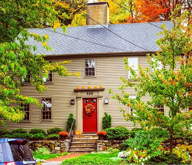 Built circa 1737, this is the A. L. Filfield House house on Main Street in Amesbury, MA, all decked out for fall 🍁🍂🍁🍂. The house is two stories high, five bays wide, with a steep gable roof and that classic central chimney. Though modest, it has some Georgian details including the fenestration symmetry and the modest pilasters and entablature around the front door. It is typical of many houses built in the area at that time. It is also located across the street from the Merrimack River and Lowell's Boat Shop, a National Historic Landmark that has been producing New England fishing dories continuously for over 200 years. Fun fact, some lucky dog just bought this place two months ago, and based on the listing photos, the interior is incredible.  Photo by @daniel_tana