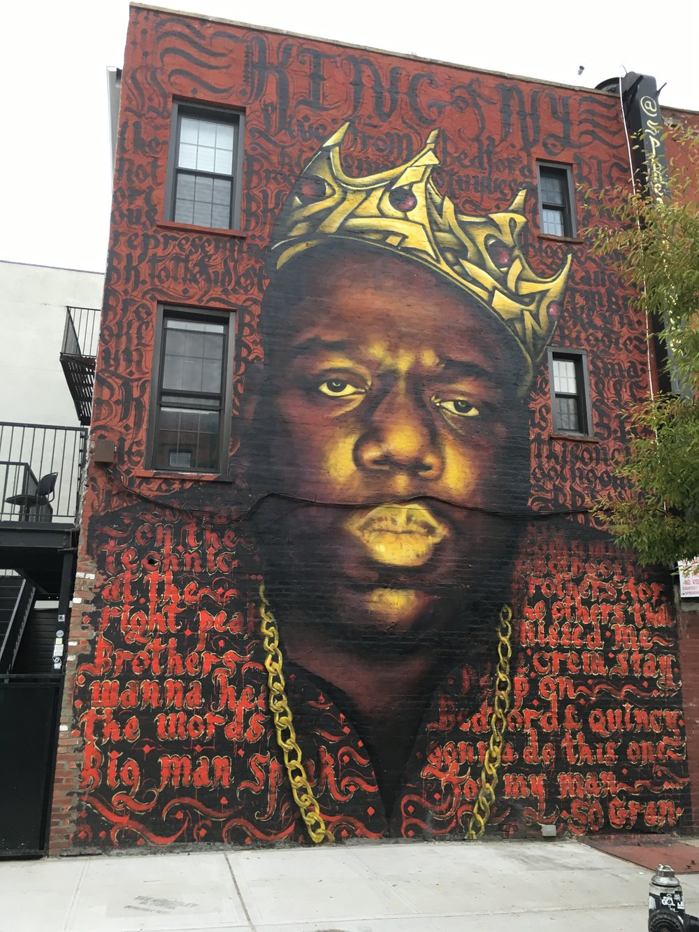Located just a few blocks from Our Place on the corner of Bedford & Quincy. Learn more about this  mural of Notorious BIG .