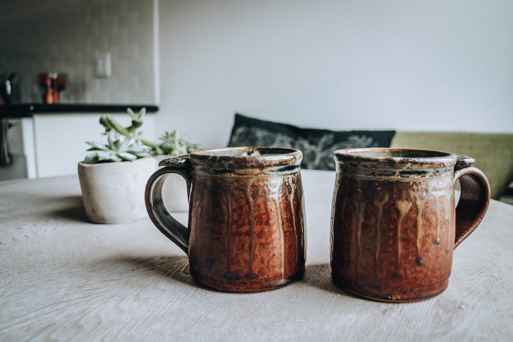 Top: We like the minimalist style, it gives room for creativity and peace of mind.  Bottom: Mugs found at garage sale, got them both for 50 cents! I love them so much because they remind me of the ones my grandma and grandpa have back home in Sweden, bringing me memories from my childhood. <3