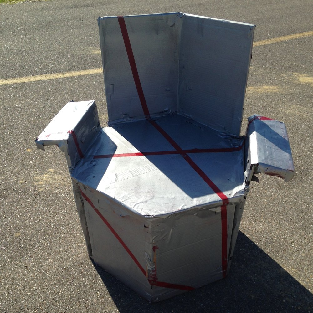 Cardboard Chair  In my eighth grade STEM class, I was assigned to create a cardboard chair with a group of fellow classmates. The chair was designed to hold the most weight possible, and collapsed after holding over 1,400 lbs.