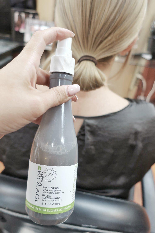 Spray hair with a texture spray like Biolage texture spray shown