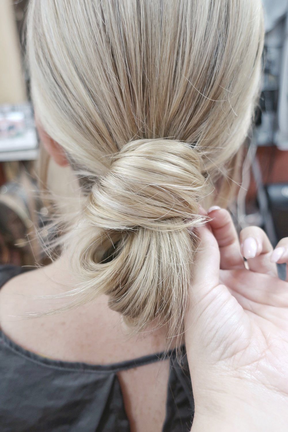 Now take the left over hair from your bun and wrap over the top of hair tie until you hit the back. Pull remainder of hair through the tie to hold in place. Use bobby pins to pin in place.
