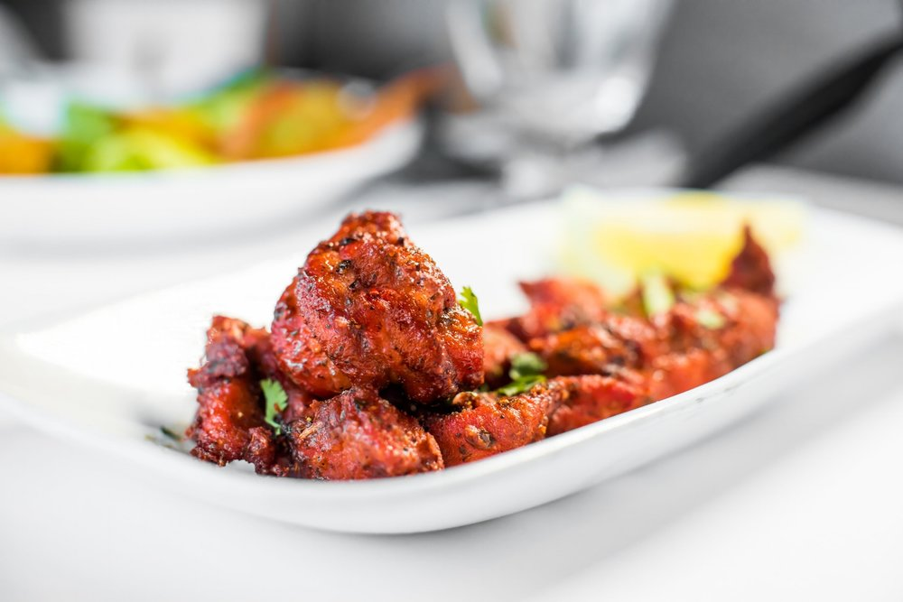 Chicken 65 - A famous dish from Hyderabad, Marinated and crispy fried in Indo-Chinese style.                                      $8