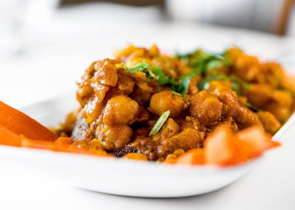 Aloo Tikki Choley  - Crispy potato patties served with homemade Choley with three sauces.                                                $10