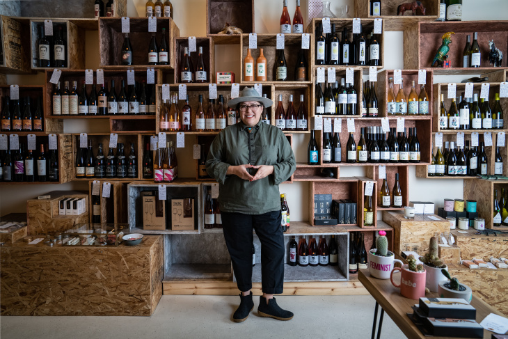Coly Den Haan, owner of Silver Lake wine store Vinovore. (Jon Endow for LAist)
