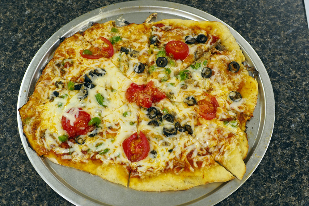 Vegetarian Pizza - Your choice of available vegetables! Green Peppers, Banana Peppers, Jalapenos, Caramelized Onions, Onions, Black Olives, Fresh Tomato's, Mushrooms and Fresh Shredded Mozzarella Cheese.$12