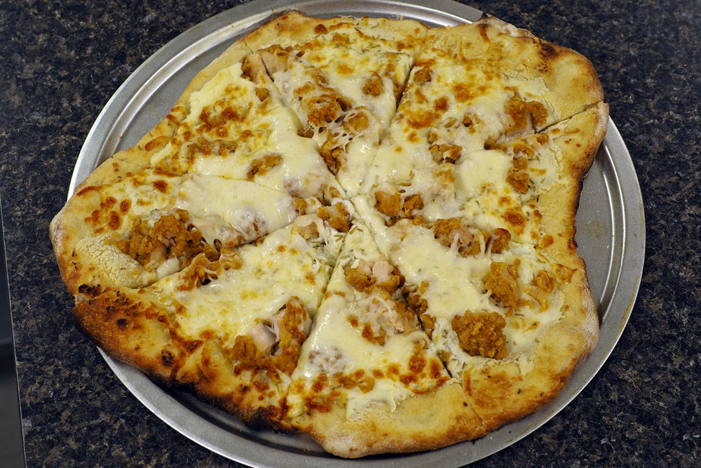 BBQ Chicken Pizza - Chicken, Caramelized Onions, Bacon, BBQ sauce, Ranch Dressing and Fresh Shredded Mozzarella Cheese$12