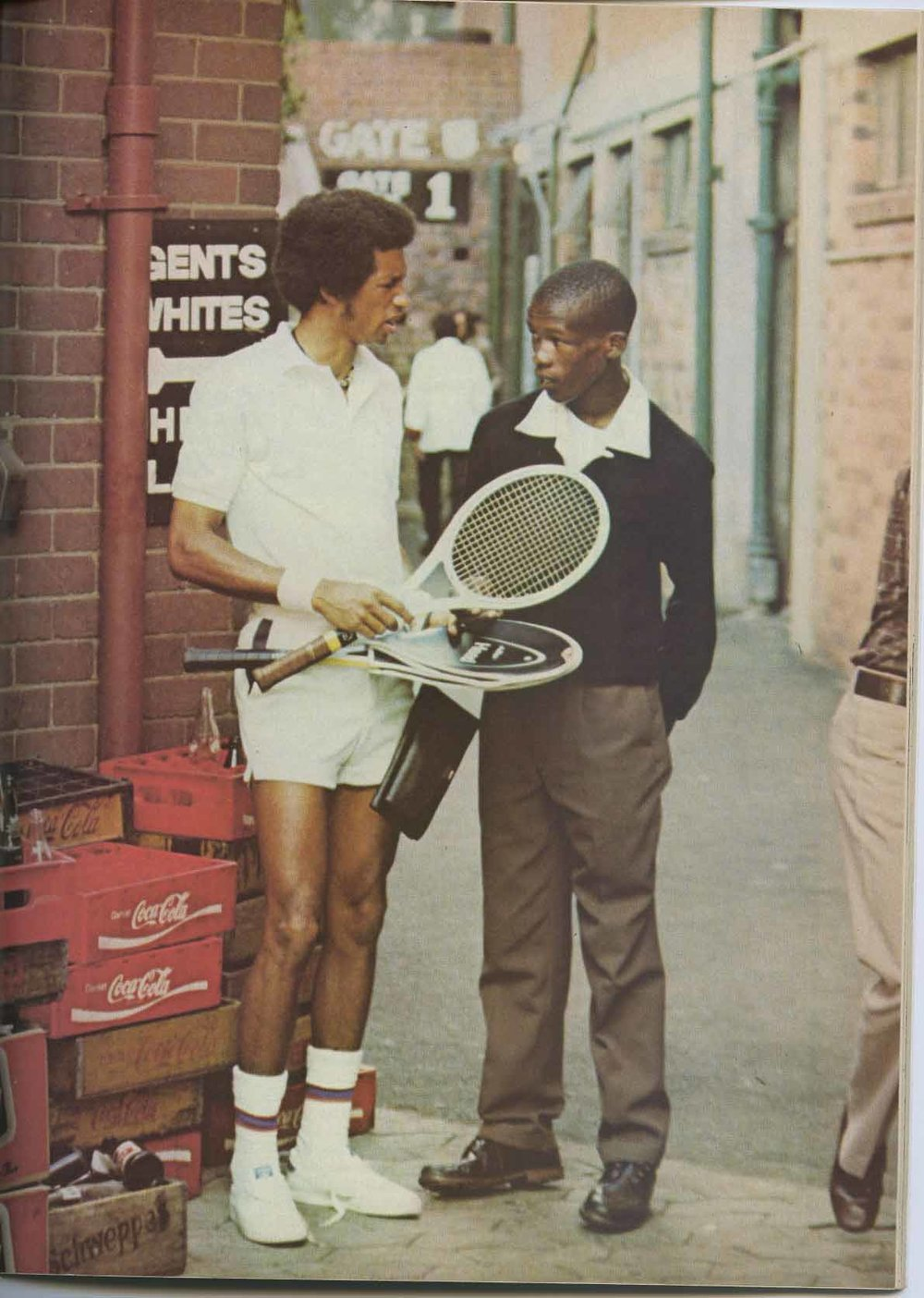 6173_P_JeanneAshe_With Arthur in South Africa World Tennis Magazine Feb 1974.jpg