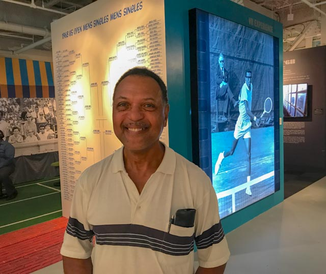 Charles Smith, NJ teaching pro and former ATA player, came by the VR Exhibition to share remembrances of watching Arthur in person in the 1968 US Open finals. He then located an image of his 1968-self in the large photo in the back, frame left!