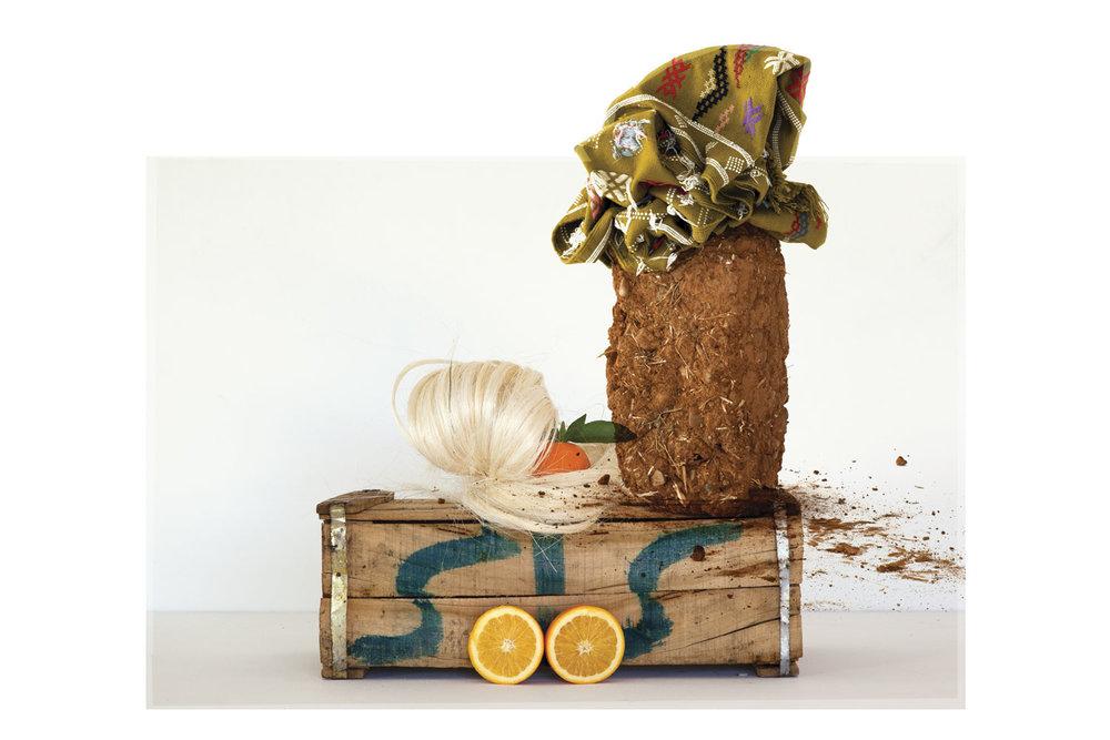Sculpture (crate, oranges, rug, rammed earth, hemp)