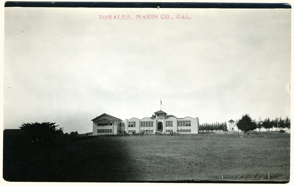 Post card of the enlarged and remodeled Tomales High School. The school's Mission Revival style section (right) was lost to a fire in 1977, but the front-gabled gymnasium/auditorium was saved and is now home to the History Center. Photo by Ella Jorgensen, circa 1921.