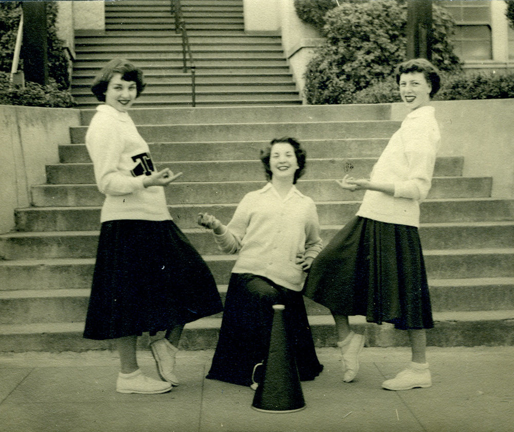 Tomales High School yell leaders  (l‒r)  Beverly Fiori, Louise Gonnella, and Lois Thompson, at the school's front steps,1950.