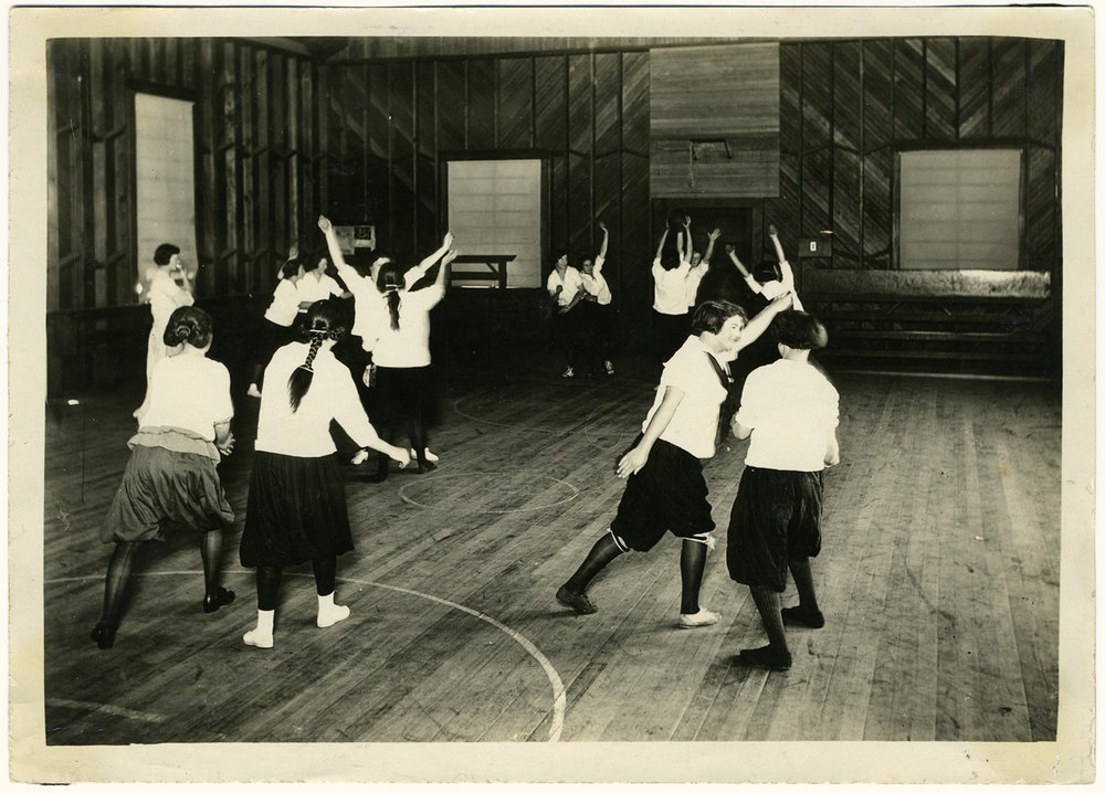 A 1923 modern dance class at Tomales High School's newly built (and apparently not quite finished) auditorium/gymnasium — today the History Center's museum.