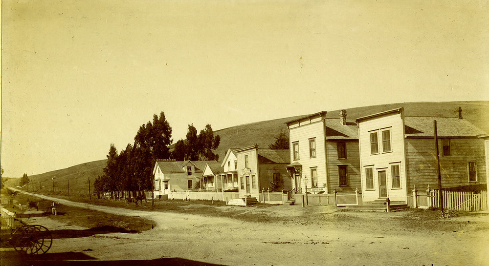 This early 1880s view of six houses on the east side of Tomales's Maine Street (Highway One) is completely recognizable today, and illustrates how an enduring environment can encourage a sense of the continuity of life.