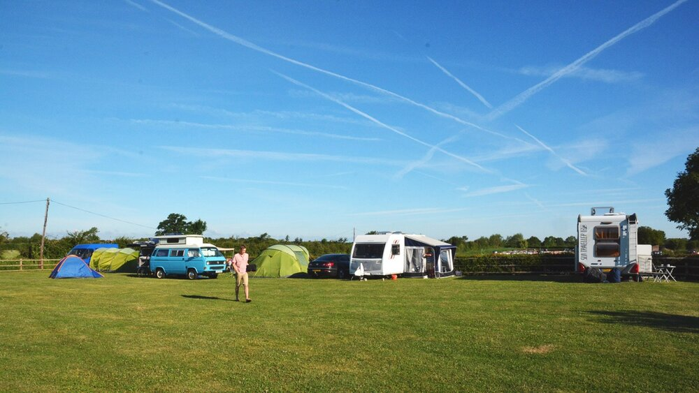 Camping field at Wigrams Turn with 10 pitches suitable for a combination of caravans, campervans and tents