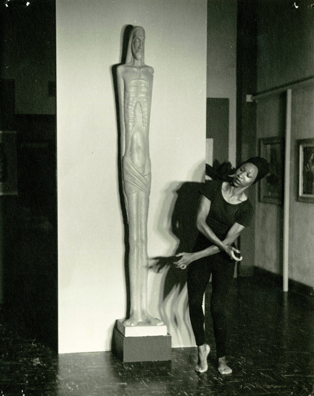 c1940s_christine_buster_next_to_a_statue.jpg