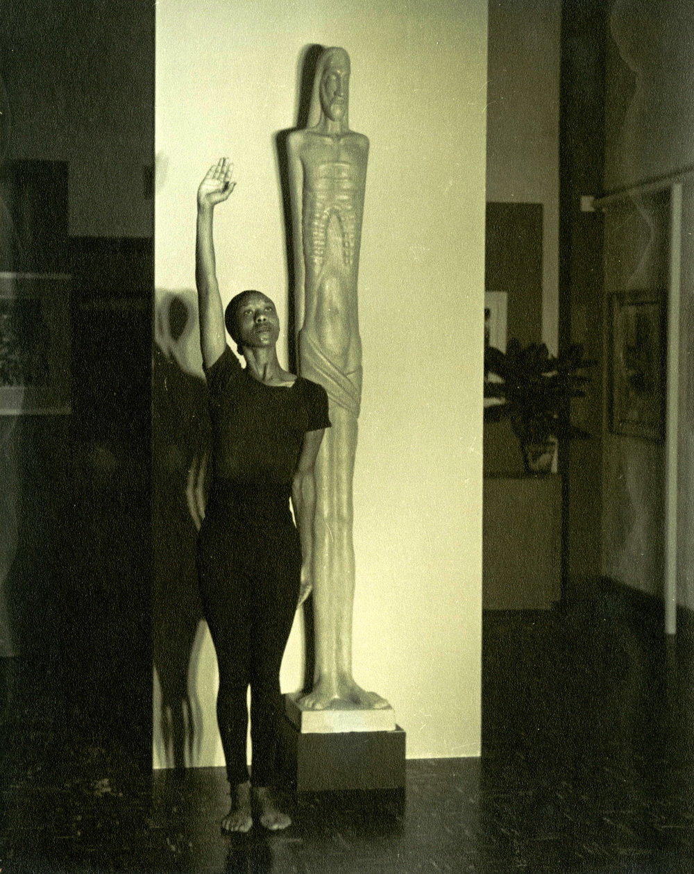 c1940s_christine_buster_next_to_a_statue_2.jpg