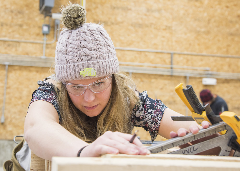Brelyn LaFreniere, a first year student in the Sustainable Construction program, prepares to make an angle cut. Following graduation, she plans to pursue an engineering-related degree at the University of Maine in Augusta. Photo: Elise Klysa
