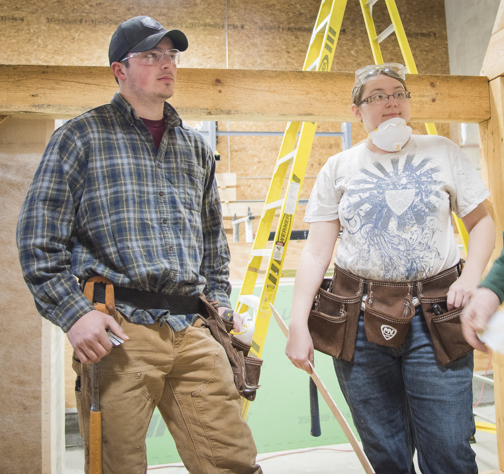 Students Vincent Birtwell and Heather Huston listen to the instructor describe various insulation options in Building Envelope II class. Birtwell and other students enjoy the mix of classroom and hands-on training offered in the program. Photo: Elise Klysa