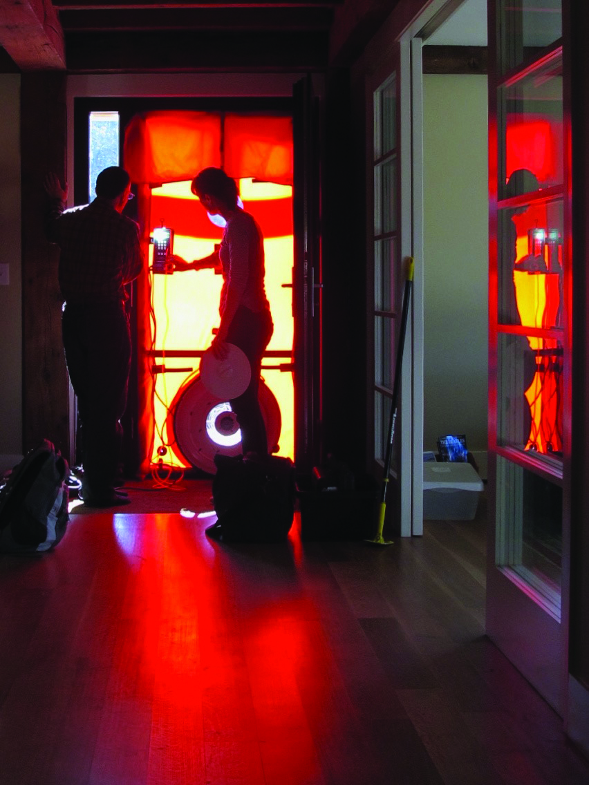 Performing a blower door test ensures the construction meets the expectations of the energy model. Photo: BrightBuilt Homes.