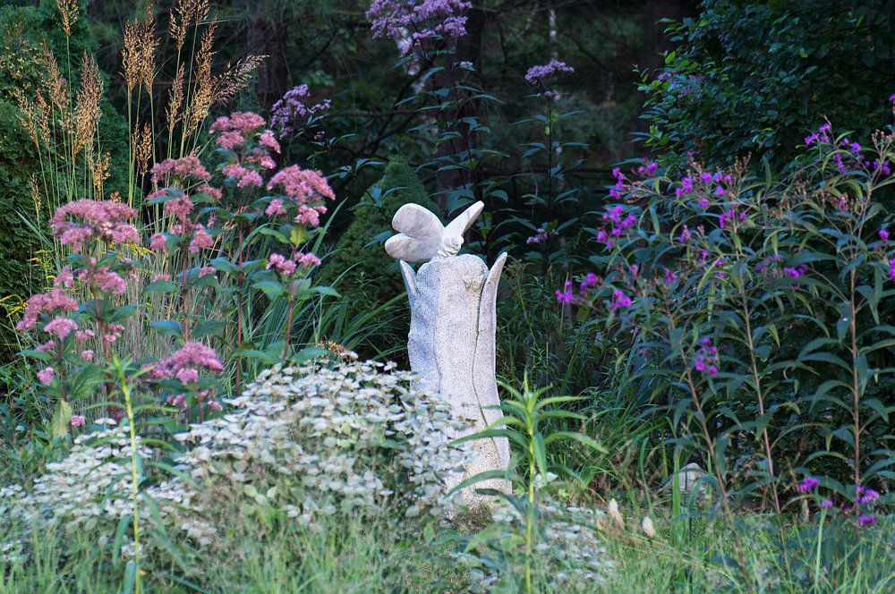 A butterfly sculpture by landscape designer Thomas Berger of Green Art in Kittery, is the ornamental centerpiece of his pollinator garden, planted with native Joe-Pye weed, mountain mint, and New York ironweed, at right. PHOTO: Green Art