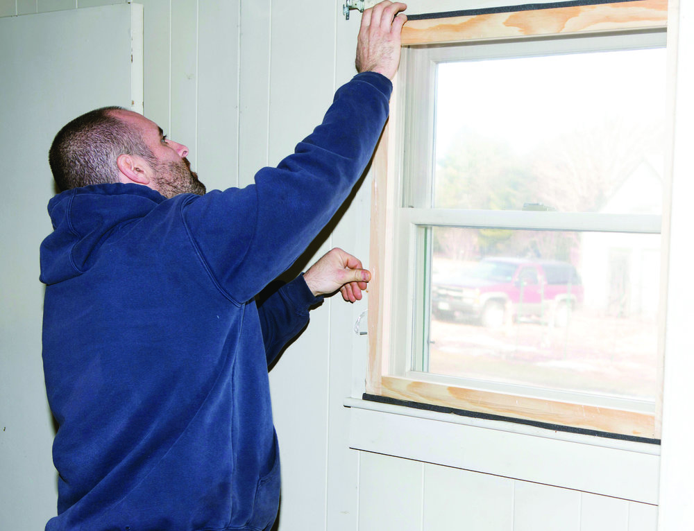 Some Habitat for Humanity affiliates in Maine are also helping to reduce the cost of home ownership by providing free home weatherization services for low income homeowners. Using volunteer labor and donated materials to built storm windows and add insulation around drafty windows and doors, these programs help homeowners to reduce their utility costs by improving the energy efficiency of their homes. (Photo courtesy of Habitat for Humanity of York County)