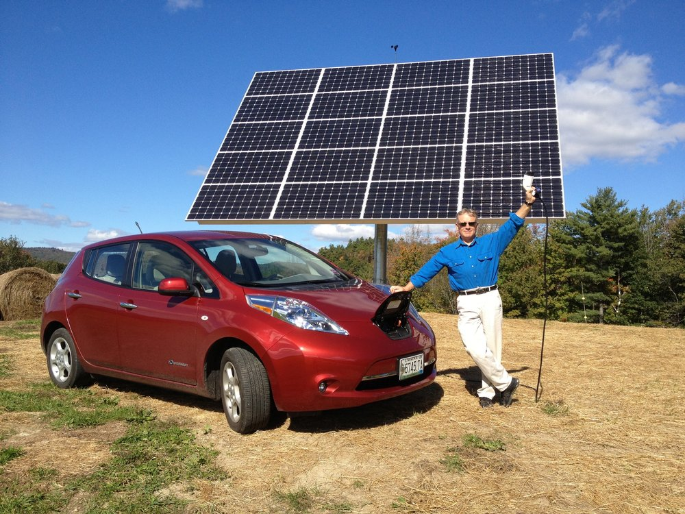 Fred Garbo of Norway, ME with the solar tracker that he uses to generate electricity for both his home and all-electric Nissan LEAF.