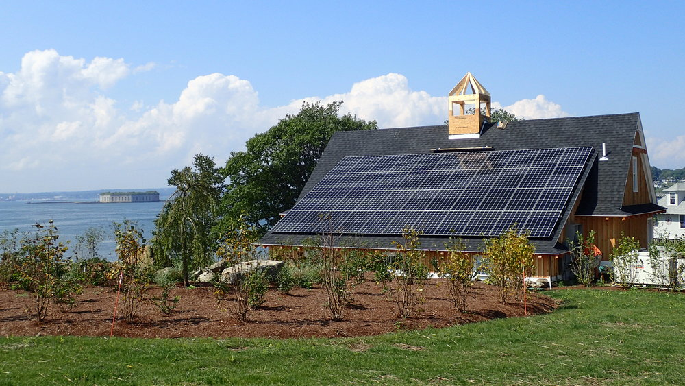 A 13.4kw off grid solar system is paired with non-toxic, long lasting Aquion salt water batteries to provide clean, reliable power to a cluster of buildings on Portland's House Island. Photo courtesy of Maine Solar Solutions