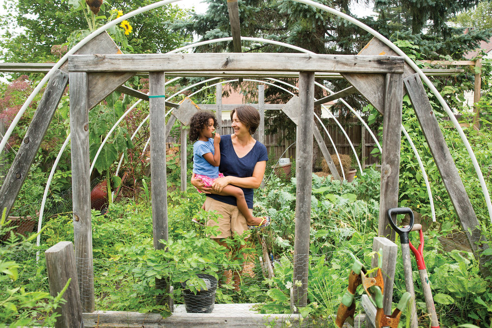 Karen Wilson constructed her hoop house from futon scrap wood to extend the season for growing favorite greens such as kale and sorrel. Photo: John Finch