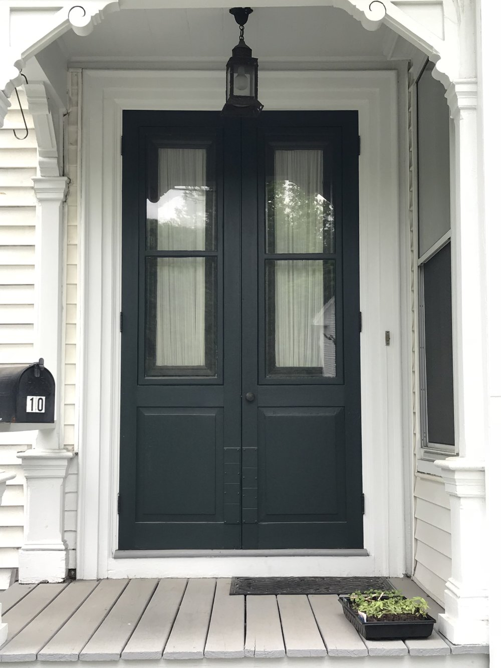 Brunswick doorway, showing storm doors that are well designed to match the original doors and provide for better efficiency. Photo: N. Barba