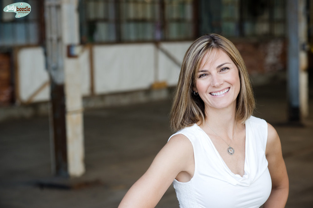 Dava, owner Portside Real Estate.  In a warehouse / August / roughly 9:11 am. Confession: we got lucky this day as this door was open so we ducked inside to get out of the sun, which gave us this great background and nice light. I have not been able to repeat this moment in this spot ever since.