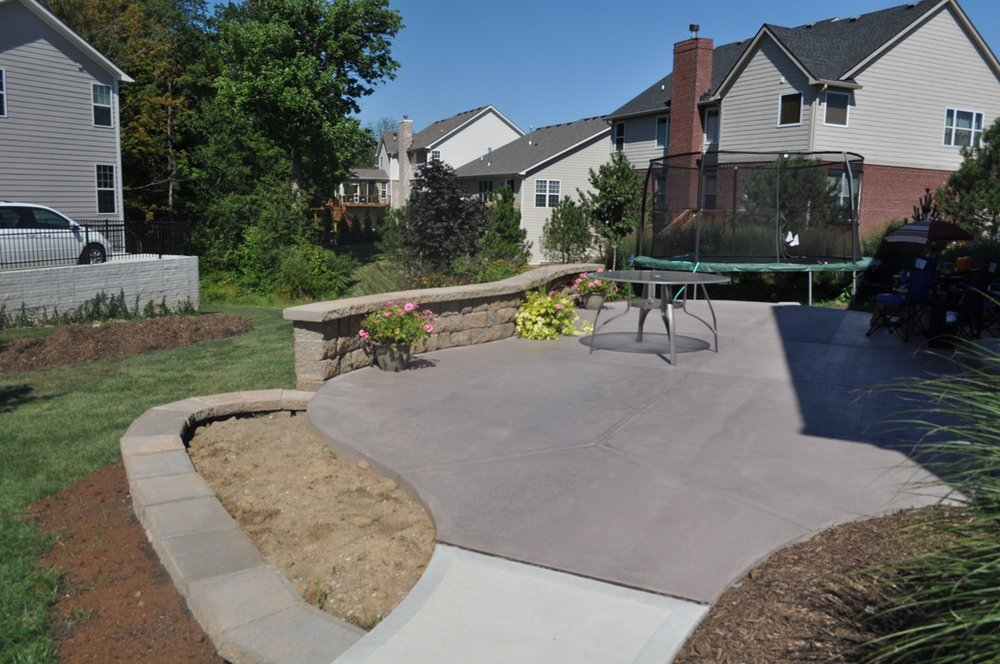 Patio with broom Taupe Davis color and Granite wall