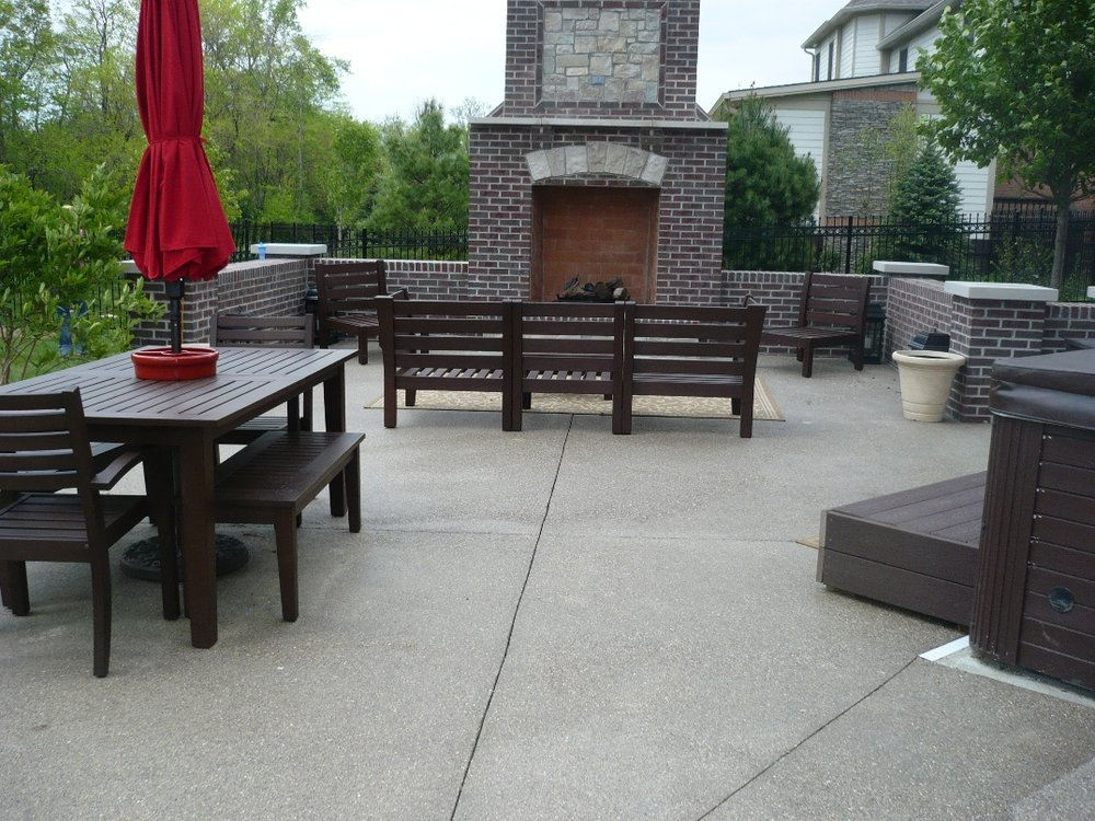 Exposed Aggregate patio with fireplace and wall