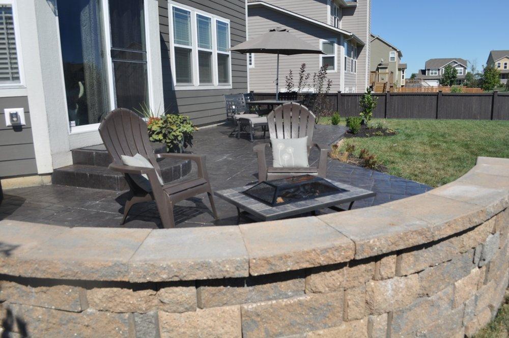 Patio Stamped, Ashlar cut stone, Dark walnut, charcoal gray release, granite wall