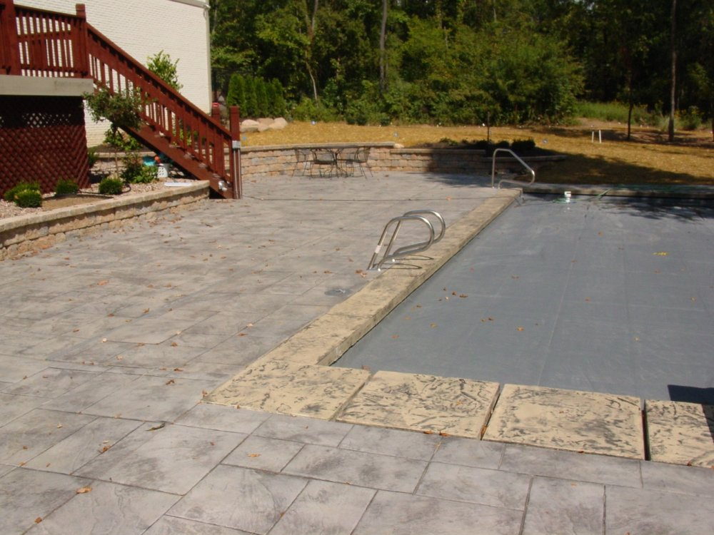 Large Ashlar Slate Stamped Concrete with Sable Color and Charcoal Gray Release Pool Deck