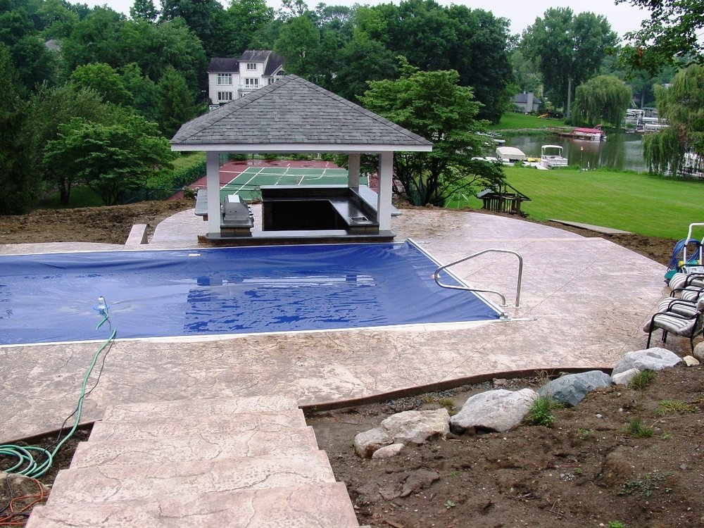 Old Granite Texture Pool Deck with Cameo Color and Autumn Brown Release with outdoor kitchen with Davis Color Pewter countertop