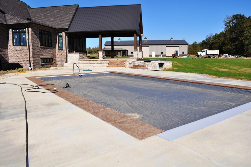 Pool deck, textured granite coping, Arizona Buff base with Walnut release, broom pool deck