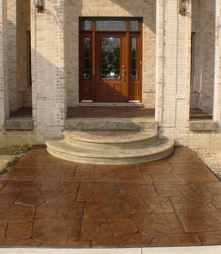Random Stone Stamped Concrete with Autumn Brown Color and Charcoal Gray Release Porch and Walkway with textured Oyster White steps