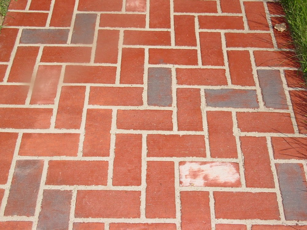 Herringbone Stenciled Concrete with brick red color, Charcoal Gray Release with Platinum and Natural white splashes 1