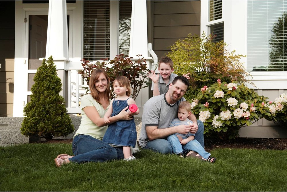 Family-photo-in-front-of-home.jpg