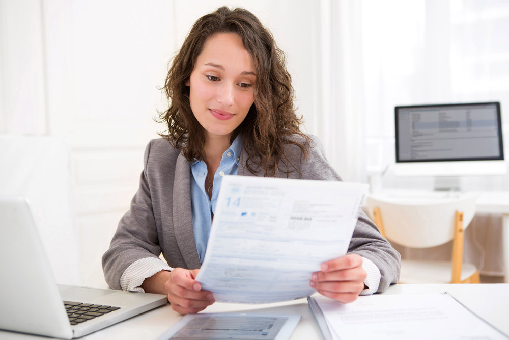 Young attractive woman doing paperwork