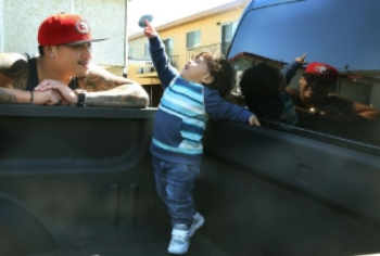 """Kevin Yip playing with his 22 month old son, Dominic King Yip. From SF Chronicle's """" Apple changes policy, no longer bars felons for construction jobs .""""."""