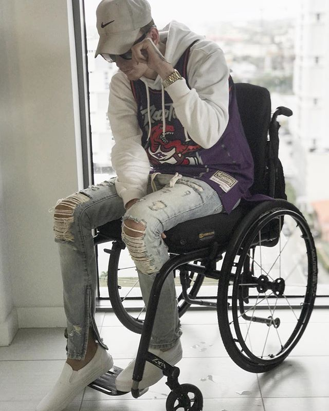Playoff bound!!! Anyone else?? . . #spinalcordinjury #sci #goingthedistance #miami #paralysis #recovery #future #guess #wheelchair #thankful #motivate #hustle #rain #ellen #success #influencer #inspire #goals #blessed #Miamiliving #style #passion #raptors #basketball #toronto #nba #heat #retro #vans