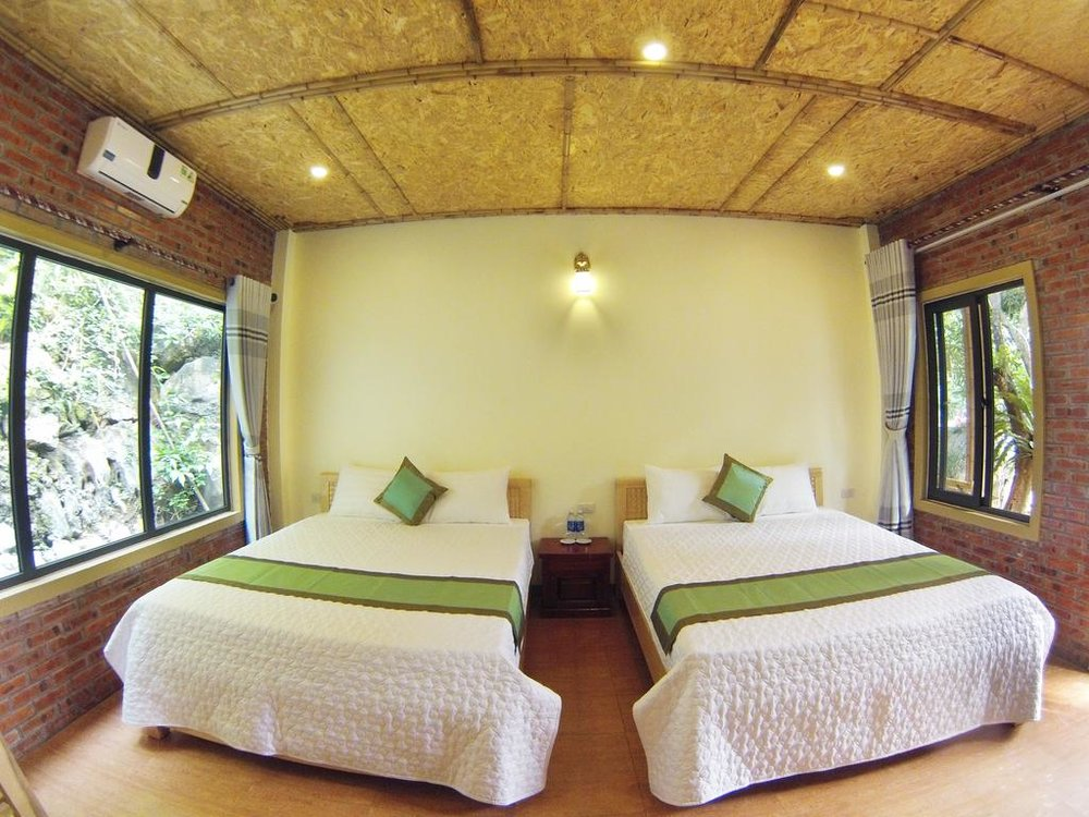 Shared Room: Double Occupancy Cabana (Double or Single Beds), Shared Bathroom and Porch